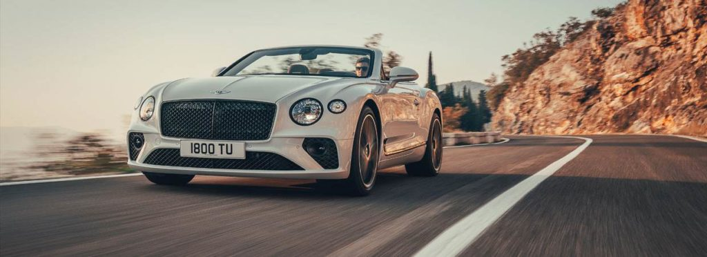 White Bentley Continental GTC with top down