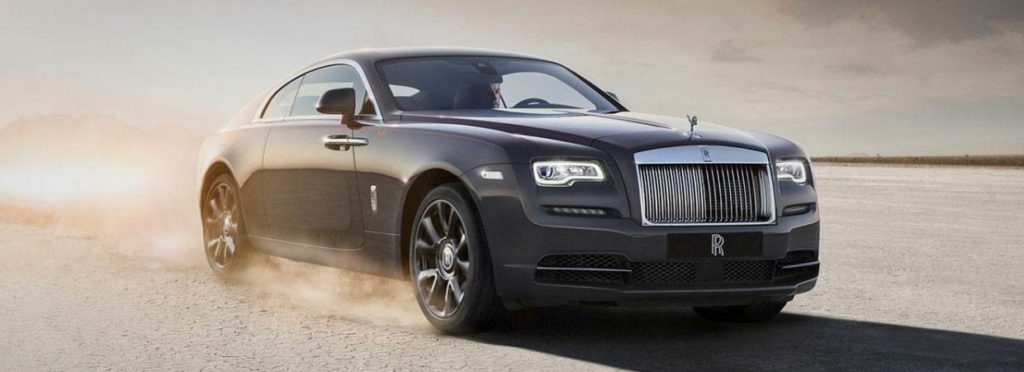 Dark grey Rolls-Royce Wraith driving through desert