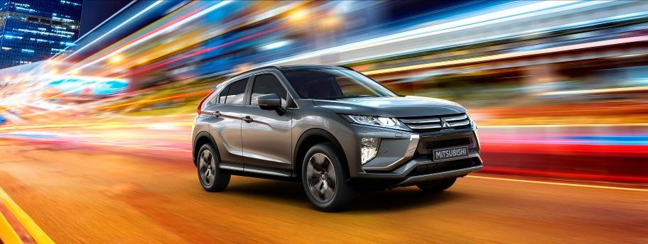 Silver Mitsubishi Eclipse Cross with light trails in background